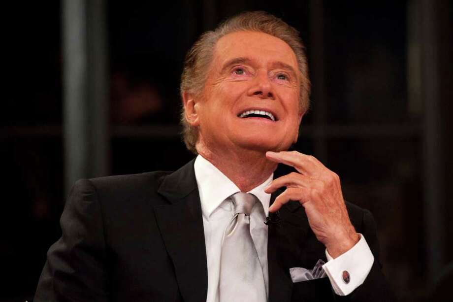 """Regis Philbin shares a laugh during his farewell episode of """"Live! with Regis and Kelly"""", in New York, Friday, Nov. 18, 2011.  After more then  28 years, Philbin signed off U.S. morning television on Friday, long after setting a world record for the most time on TV.   Philbin,  80,  has logged more than 17,000 hours on television in a career that dates back to the 1960s. He gained prime-time fame as host of """"Who Wants to Be a Millionaire"""" a decade ago. But his enduring impact was as a morning show host, turning stories about something as simple as a dinner out on the town into compelling viewing.   (AP Photo/Charles Sykes) Photo: Charles Sykes, FRE / FR170266 AP"""