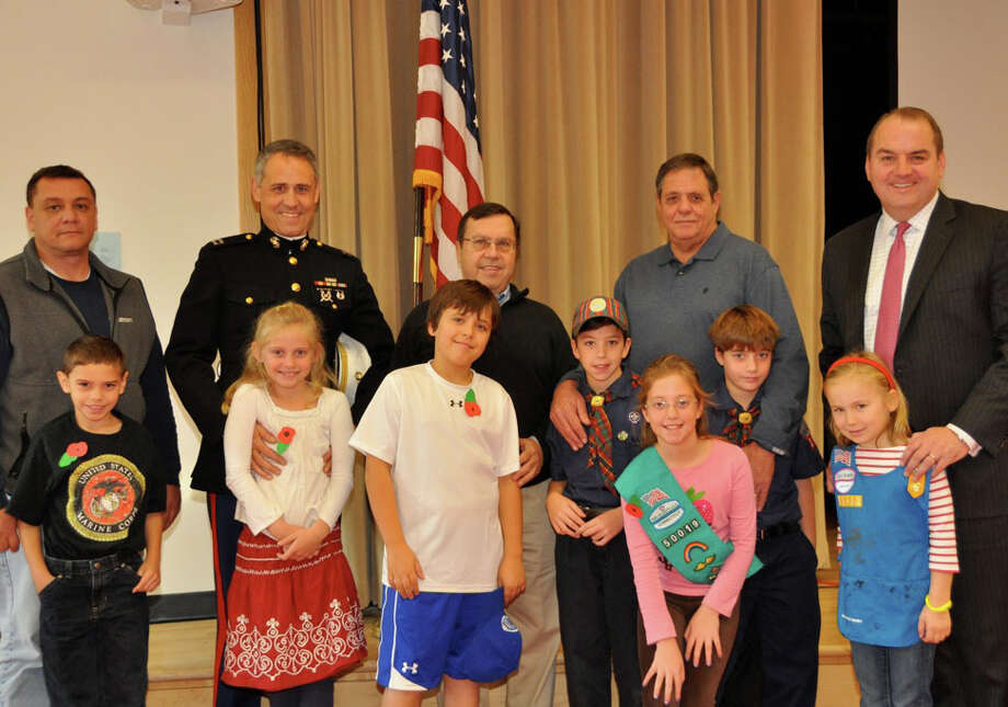 Pictured are proud Tokeneke children of the veterans, with their fathers who served. From left, Richard  Aponte with his son, Nick; Michael Harman with his daughter, Hailey; Joe Laughon with his son, Walker; George Chieffi with his children, Teddy, Genevieve and George; and John Nelson with his daughter, Annika. Photo: Contributed Photo