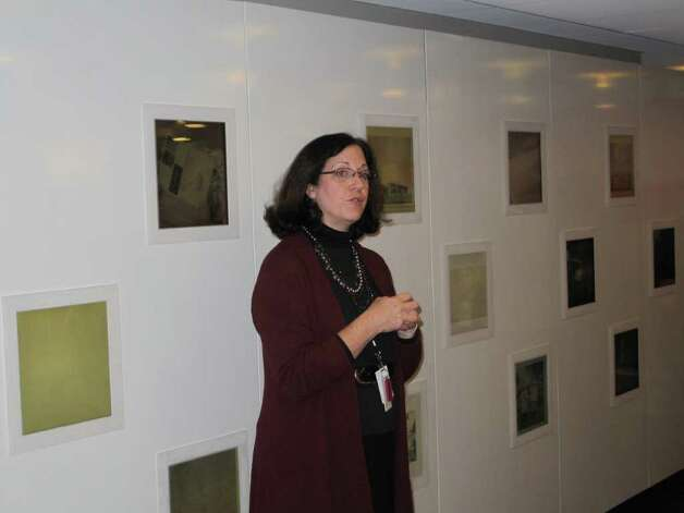 Peggy Dannemann, one of the tour guides, introduces Johnson's work in front of the media wall at the visitor's center. Photo: Paresh Jha