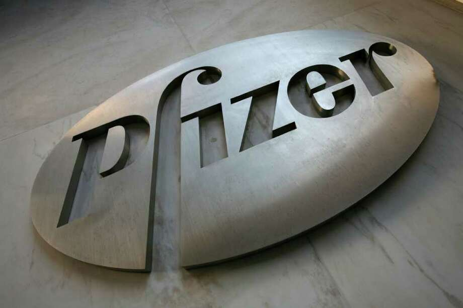 FILE - This Jan. 25, 2009 file photo, shows a sign at Pfizer world headquarters in New York. Since the start of the recession in Dec. 2007, S&P 500 companies have borrowed an additional 40 cents for every dollar they've hoarded in cash. For many companies, debt has risen more than cash. Drugmaker Pfizer added $3.5 billion to cash from the start of the recession through June. But it added $28 billion of debt, according to FactSet. PepsiCo added $22 billion more debt than cash. Hewlett-Packard added $16 billion more, Wal-Mart $6.5 billion. (AP Photo/Mark Lennihan, file) Photo: Mark Lennihan / AP2009