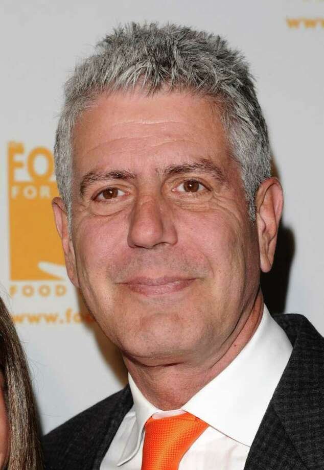 "FILE - In this April 7, 2011 file photo, Anthony Bourdain attends the Food Banks 'Can Do Awards' gala in New York. Bourdain's  new Travel Channel series, ""The Layover,"" premieres Monday at 9 p.m. EST. (AP Photo/Peter Kramer, file) Photo: Peter Kramer / AP2011"