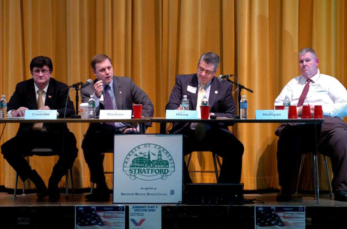 Stratford Republican mayoral candidate state Rep. John Harkins, second from left, speaks during Wednesday night's mayoral debate at Stratford High School, sponsored by the Stratford Chamber of Commerce and League of Women Voters.
