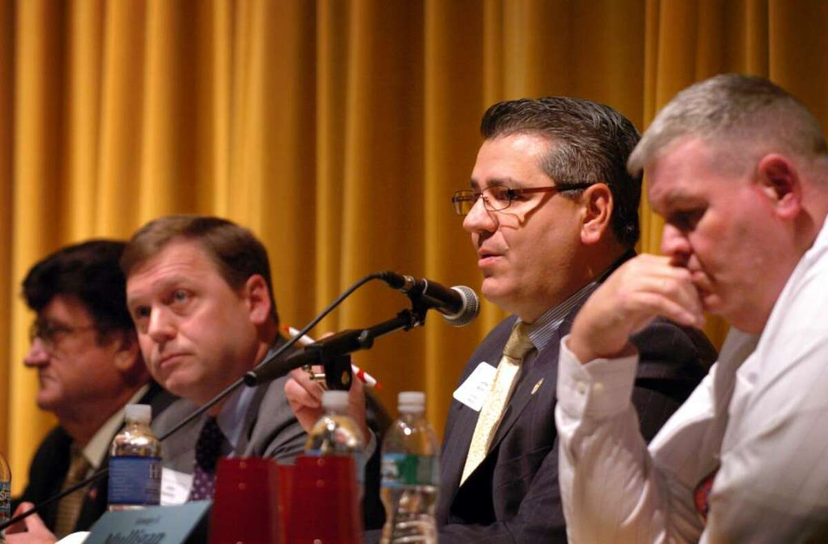 Stratford Mayor James R. Miron addresses a question posed during Wednesday night's mayoral debate at Stratford High School, sponsored by the Stratford Chamber of Commerce and League of Women Voters.