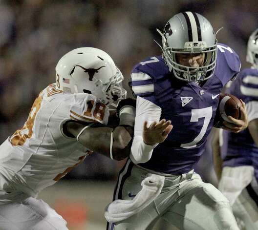 Kansas State quarterback Collin Klein (7) gets past Texas linebacker Emmanuel Acho (18) as he runs for a touchdown during the second quarter of a college football game against Saturday, Nov. 6, 2010 in Manhattan, Kan. Photo: AP