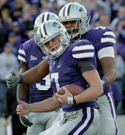 Kansas State quarterback Collin Klein (7) celebrates after scoring a touchdon during the second quarter of an NCAA college football game against the Texas A&M, Saturday, Nov. 12, 2011, in Manhattan, Kan. Photo: AP