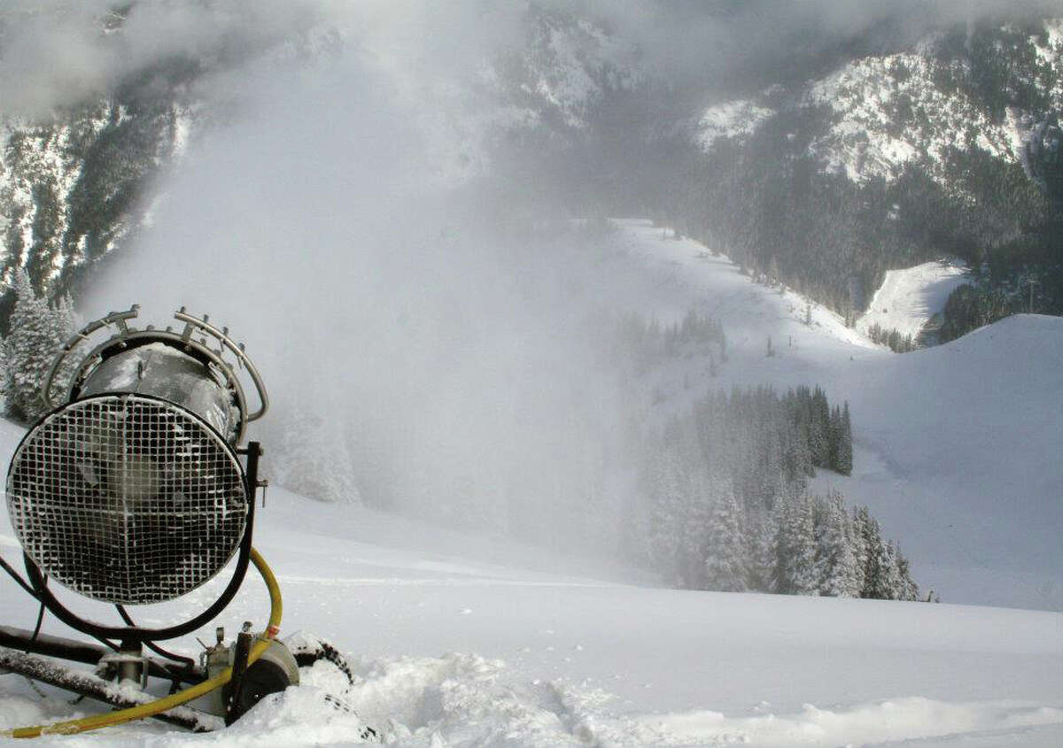 Snow is blown down a slope at Crystal Mountain Resort on Nov. 15, 2011.