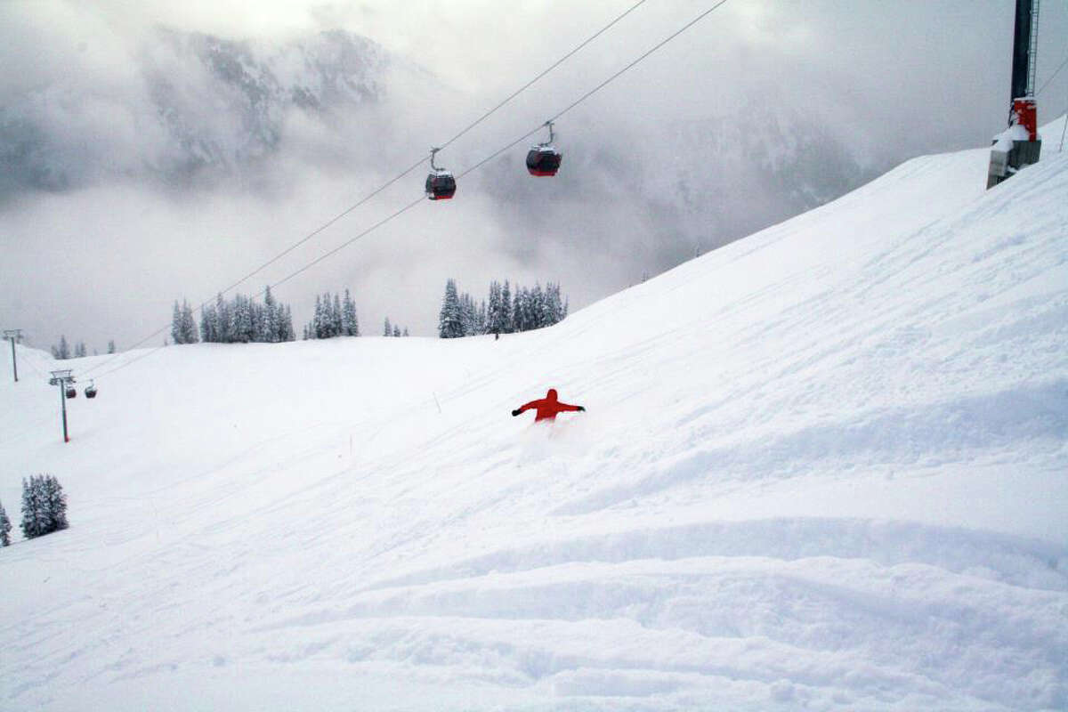 A snowboarder is seen on opening day at Crystal Mountain Resort on Nov. 18, 2011.
