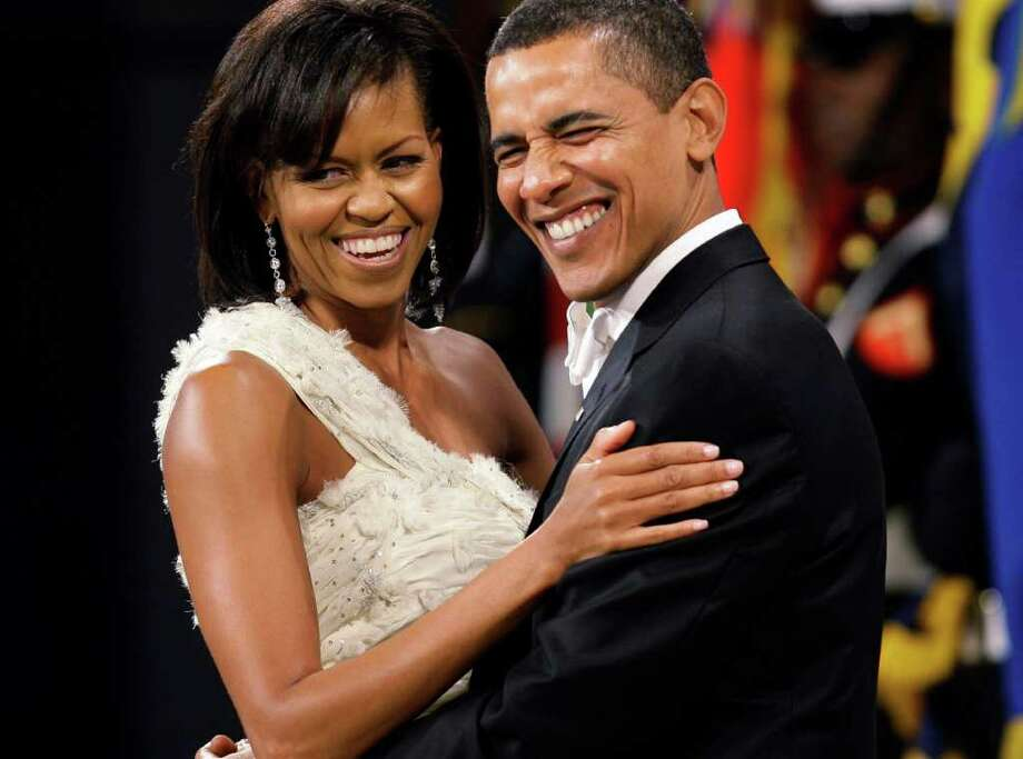 This Jan. 20, 2009 file photo shows President Barack Obama and first lady Michelle Obama dancing together at the Obama Home States Inaugural Ball in Washington. A new exhibit opens Nov. 19, 2011, at the Smithsonian's National Museum of American History will feature the gown the first lady wore to the inaugural balls. Photo: Charlie Neibergall, Associated Press / AP