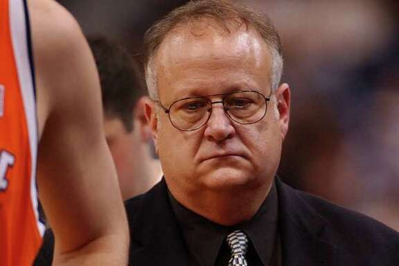 This Feb. 10, 2003 photo shows Syracuse assistant basketball coach Bernie Fine during a game against the University of Connecticut, in Hartford, Conn. Fine was placed on administrative leave Thursday, Nov. 17, 2011 after old child molesting allegations resurfaced, just two weeks after a child sex abuse scandal rocked Penn State.  (AP Photo/The Post-Standard, Stephen D. Cannerelli)  INTERNET OUT TV OUT MAGS OUT NO ARCHIVE