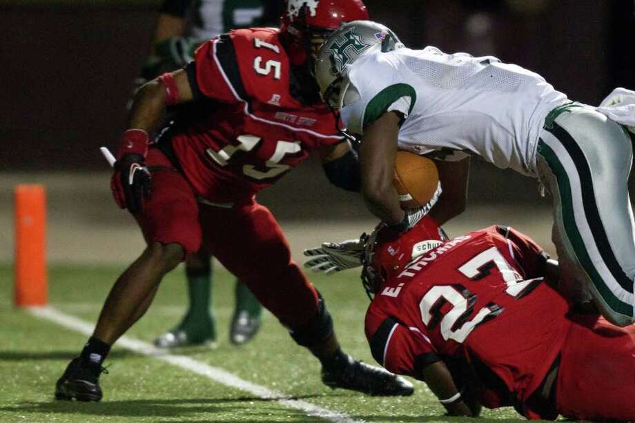 Hightower running back Joshua Wilhite (3) pushes his way into the end zone for a touchdown past North Shore defenders Earnest Thomas (27) and Kevin Alexander Photo: Smiley N. Pool, Houston Chronicle / © 2011  Houston Chronicle