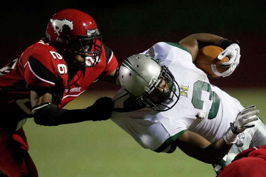 Hightower running back Joshua Wilhite (3) is dragged down by North Shore defensive back Keon Harvison Photo: Smiley N. Pool, Houston Chronicle / © 2011  Houston Chronicle