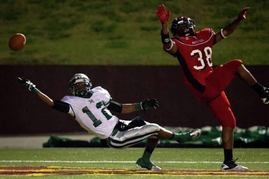 North Shore defensive back Cory Collins (38) breaks up a pass in the end zone intended for Hightower wide receiver Joseph Giles Photo: Smiley N. Pool, Houston Chronicle / © 2011  Houston Chronicle