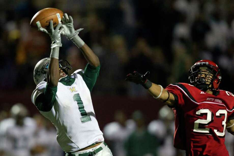 Hightower wide receiver Ryan Nelson (1) has a pass go off his fingertips as North Shore defensive back Jacoby Walker Photo: Smiley N. Pool, Houston Chronicle / © 2011  Houston Chronicle