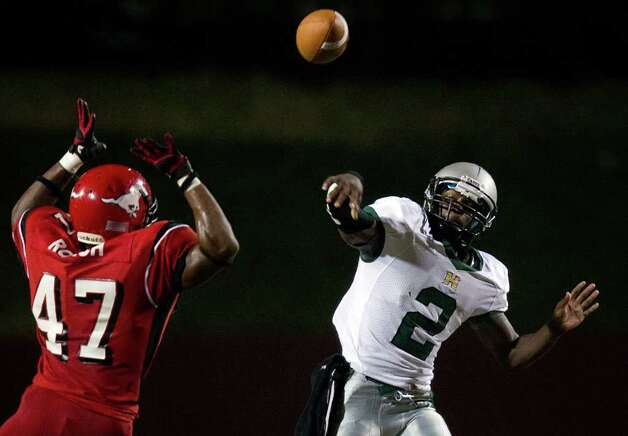 Hightower quarterback Bralon Addison (2) fires a pass over North Shore defensive lineman Troy Roach Photo: Smiley N. Pool, Houston Chronicle / © 2011  Houston Chronicle
