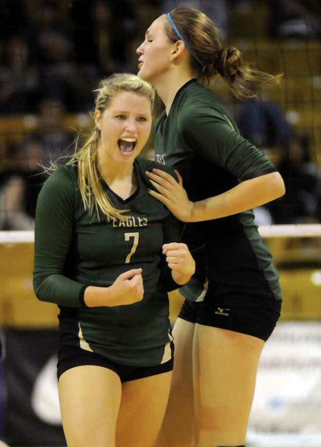 Cy-Falls junior setter Kelly Bailey, left, with teammate Patricia Van Pelt, gets fired up during the Golden Eagles' Class 5A state volleyball semifinal versus McKinney Boyd at Strahan Coliseum on the campus of Texas State University in San Marcos on Friday.  Photo: Jerry Baker, For The Chronicle