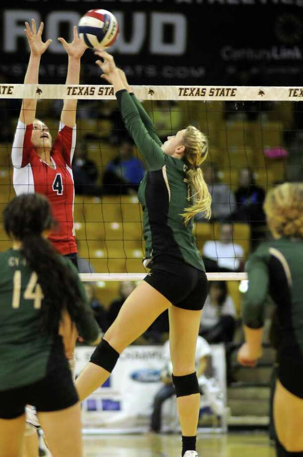 Cy-Falls junior setter Kelly Bailey, center, goes one-on-one at the net against McKinney Boyd's Drew Darling (#4) during the third game of their Class 5A state volleyball semifinal at Strahan Coliseum on the campus of Texas State University in San Marcos on Friday. Freelance photo by Jerry Baker Photo: Jerry Baker, For The Chronicle