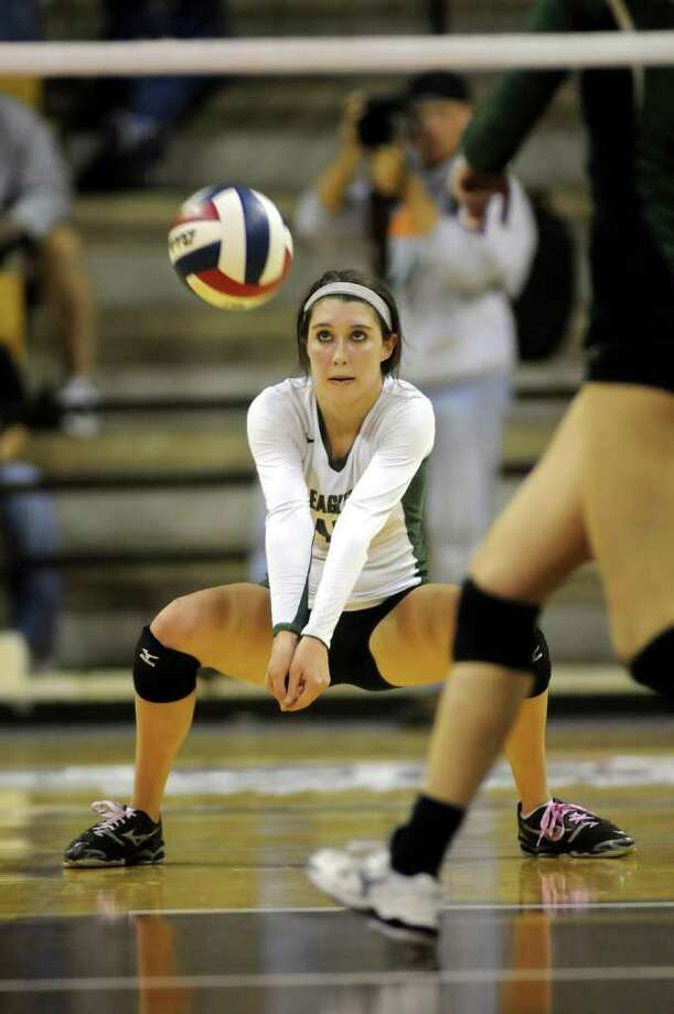 Cy-Falls senior Libero Brittnee Dawley goes low for a dig during the Golden Eagles' Class 5A state volleyball semifinal versus McKinney Boyd at Strahan Coliseum on the campus of Texas State University in San Marcos on Friday. Freelance photo by Jerry Baker Photo: Jerry Baker, For The Chronicle