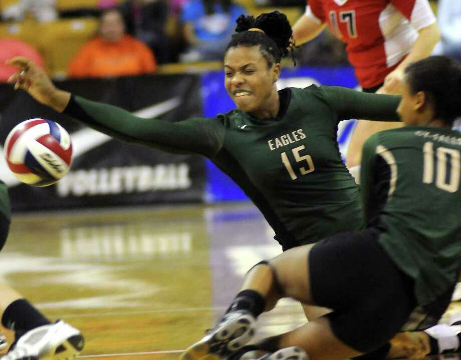 Cy-Falls senior Chanel Clark-Bibbs (#15) goes to the floor for a dig in front of teammate Mylan Eugene (#10), a sophomore, during the Golden Eagles' Class 5A state volleyball semifinal versus McKinney Boyd at Strahan Coliseum on the campus of Texas State University in San Marcos on Friday. Freelance photo by Jerry Baker Photo: Jerry Baker, For The Chronicle