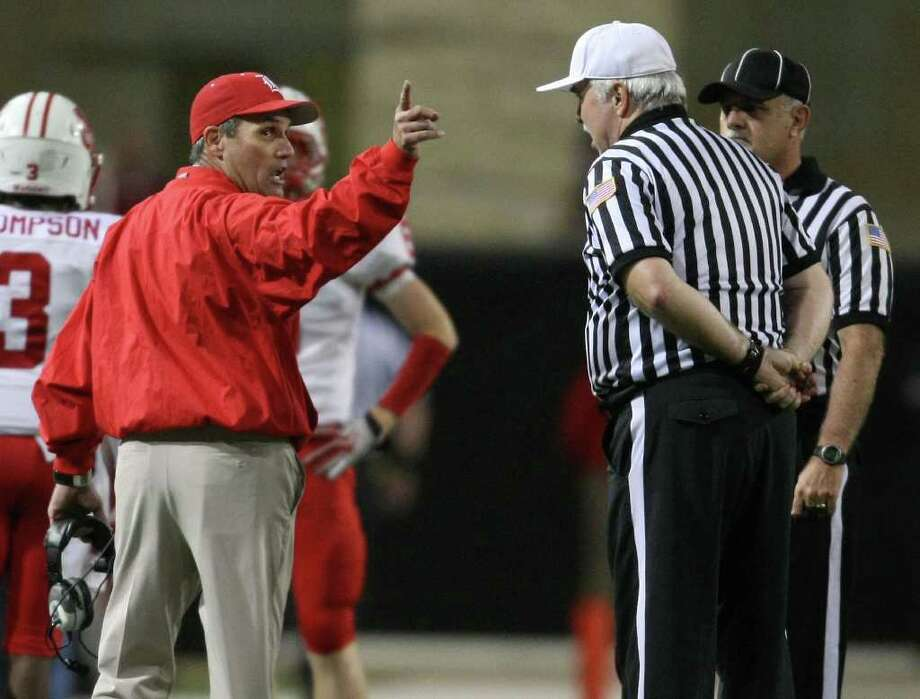 Katy head coach Gary Joseph argues a call with an official during the first half of an area playoff game against Cypress Woods, Friday, November 18, 2011 at Berry Center in Cypress. Photo: Eric Christian Smith, For The Chronicle