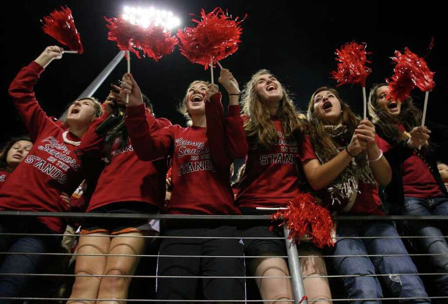 Cypress Woods students get fired up before their area playoff game against the Katy Tigers, Friday, November 18, 2011 at Berry Center in Cypress. Photo: Eric Christian Smith, For The Chronicle