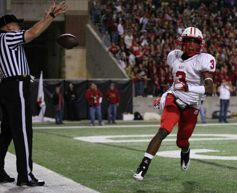Katy's Jordan Thompson (3) tosses the ball to an official after scoring a touchdown during the first half of an area playoff game against Cypress Woods, Friday, November 18, 2011 at Berry Center in Cypress. Photo: Eric Christian Smith, For The Chronicle