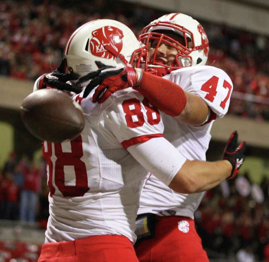Katy's Stein Spiller (88) celebrates his touchdown reception with teammate Alan Grizzaffi during the first half of an area playoff game against Cypress Woods, Friday, November 18, 2011 at Berry Center in Cypress. Photo: Eric Christian Smith, For The Chronicle