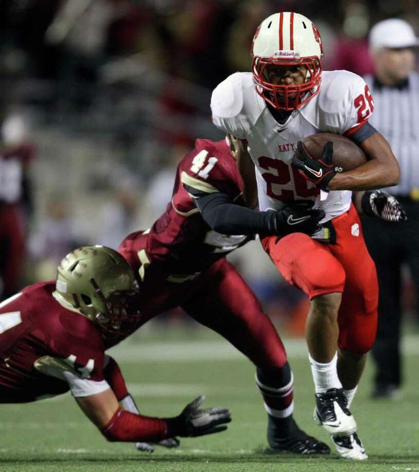 Katy's Rodney Anderson (26) is tackled by Cypress Woods' Deoundrei Davis (41) during the first half of an area playoff game, Friday, November 18, 2011 at Berry Center in Cypress. Photo: Eric Christian Smith, For The Chronicle