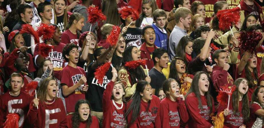 Cypress Woods students cheer the Wildcats' block of an extra point resulting in two points during the first half of an area playoff game against the Katy Tigers, Friday, November 18, 2011 at Berry Center in Cypress. Photo: Eric Christian Smith, For The Chronicle