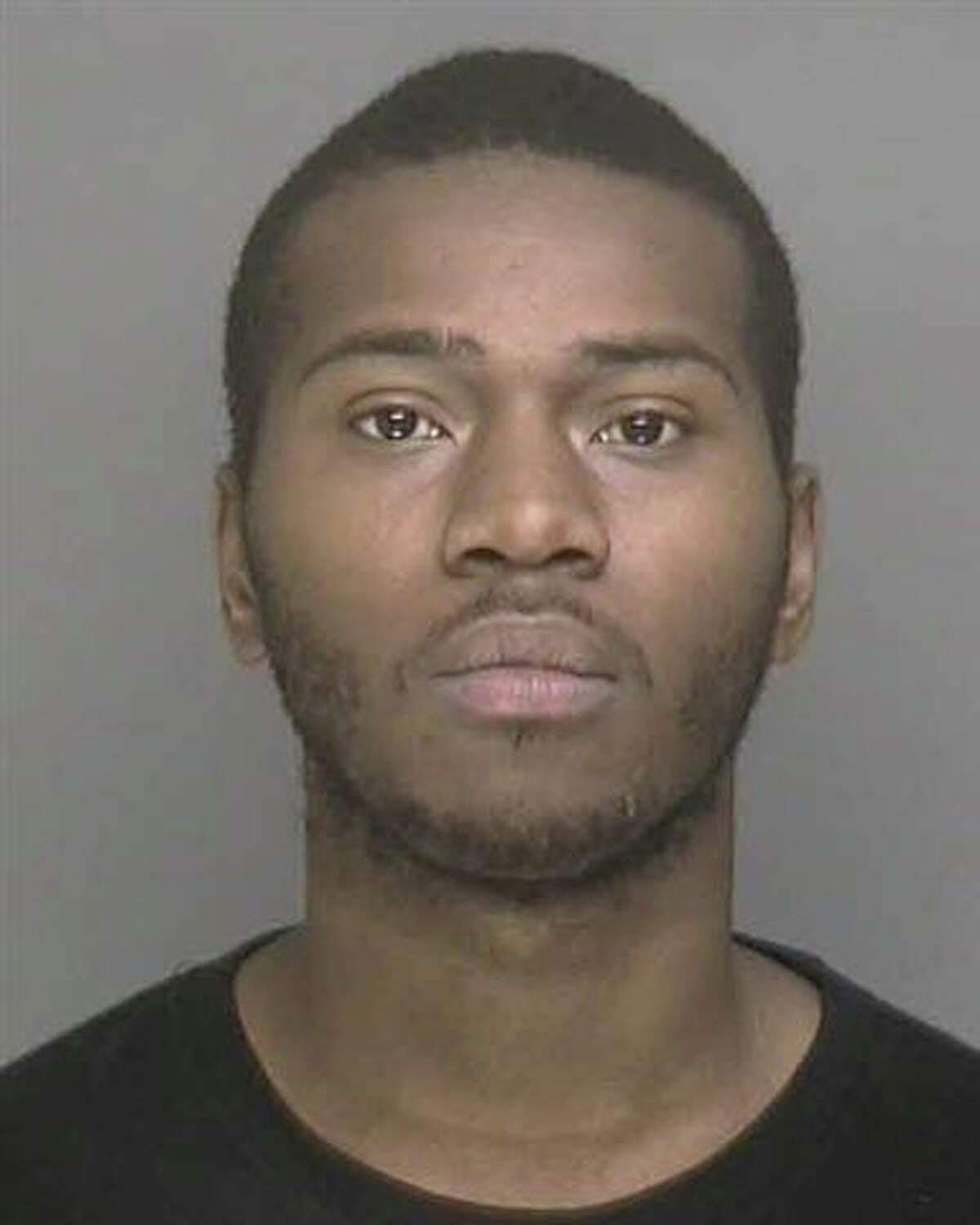 Donnell Williams, 22, was charged with killing a dog in Bridgeport and police said they found guns and drugs inside his apartment.