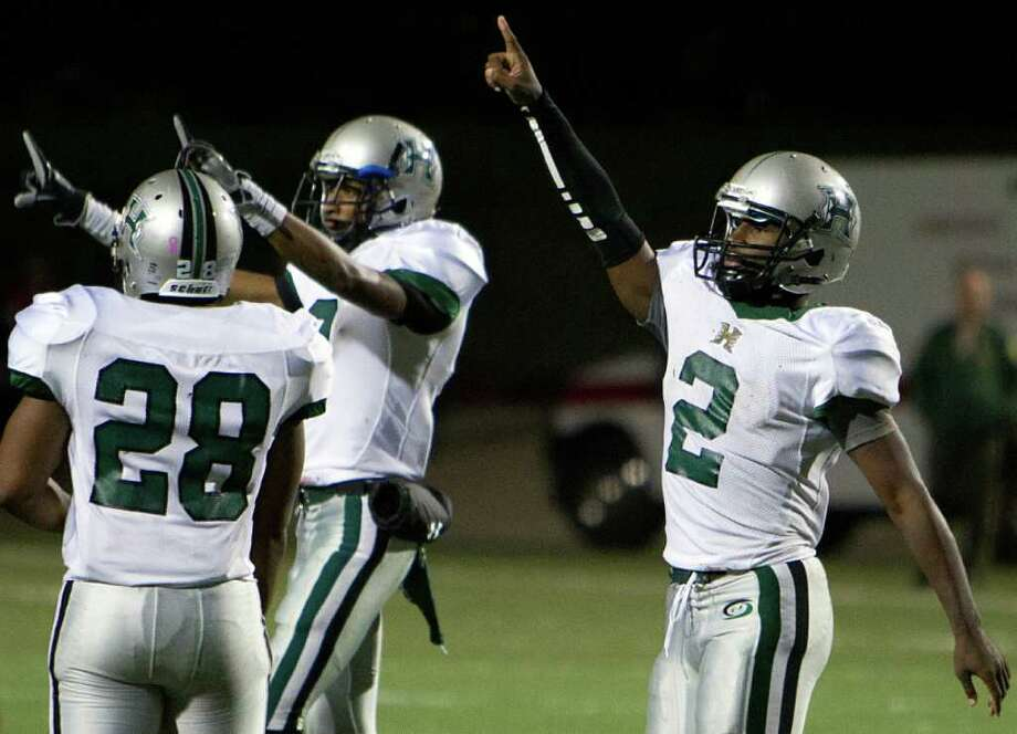 Nov. 18: Hightower 34, North Shore 21 Hightower quarterback Bralon Addison (2), running back Jaquinn Henderson (28) and wide receiver Donald Weathersby celebrate their playoff victory over North Shore. Photo: Smiley N. Pool, Houston Chronicle / © 2011  Houston Chronicle