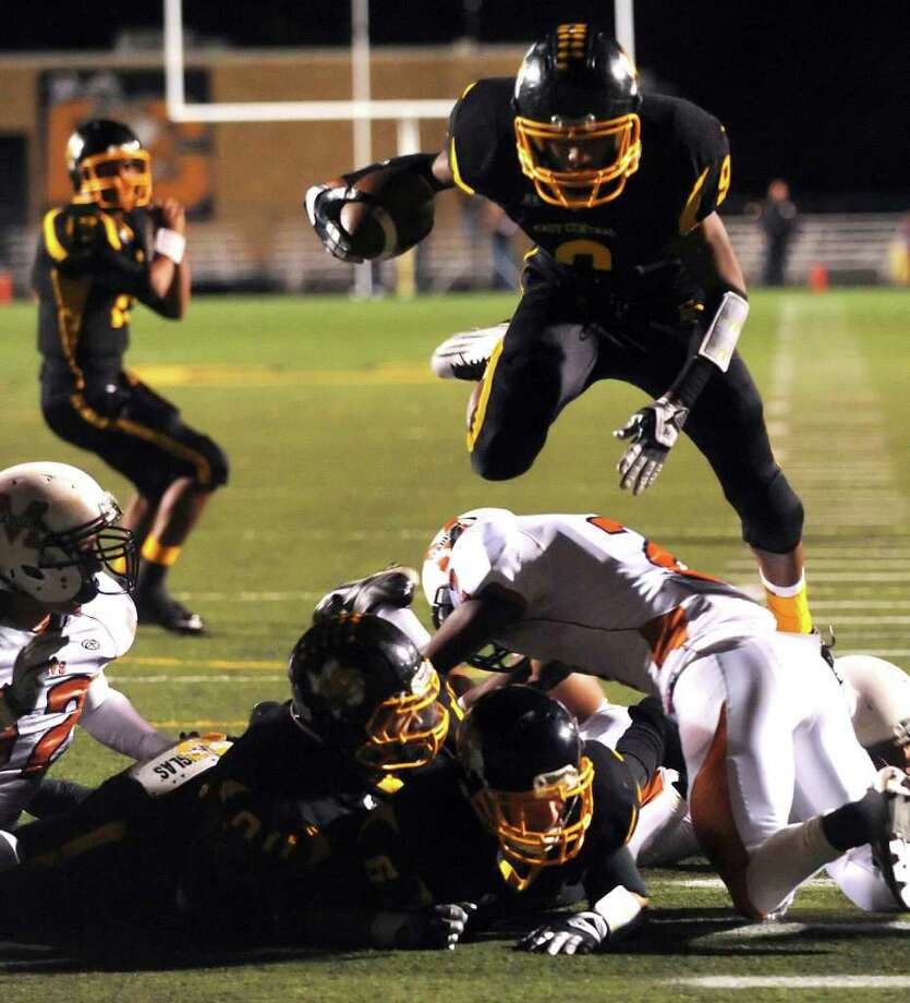 East Central's Chris Armstrong jumps into the end zone for a touchdown against Madison during Class 5A Division I football playoffs action at East Central High School on Friday, Nov. 18, 2011. BILLY CALZADA / gcalzada@express-news.net