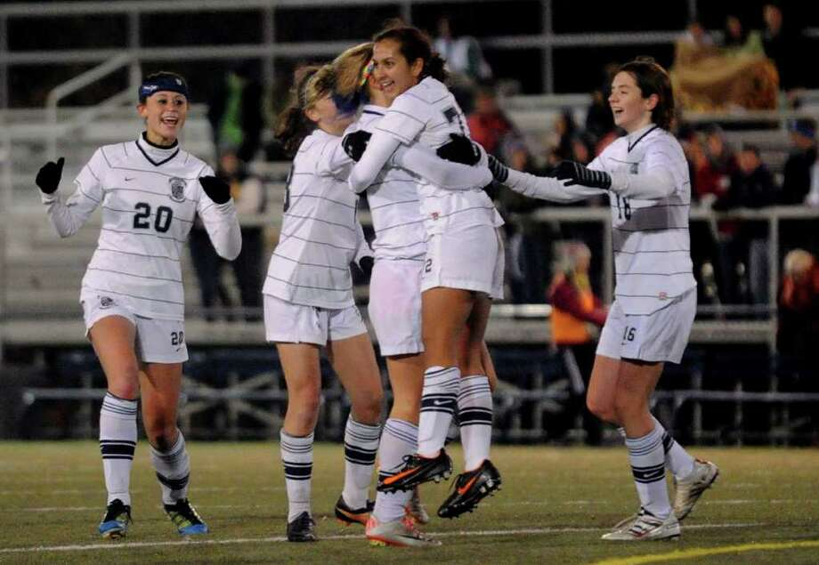 Immaculate teammates hug and surround #72 Natalia Diaz after she scored a goal against Bolton, during CIAC Girls Soccer State Tournament Class S Semifinal action in Waterbury, Conn. on Friday November 18, 2011. Photo: Christian Abraham / Connecticut Post