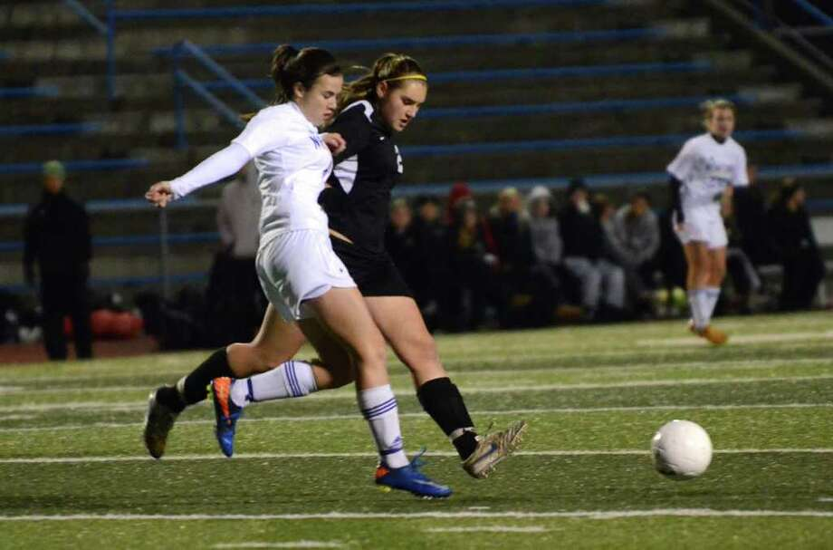 Trumbull's Lorraine Dedrick (25) takes control of the ball as Newtown's Bridget Power (6) defends during the girls soccer state tournament Class LL semifinals at Ken Strong Stadium in West Haven on Friday, Nov. 18, 2011. Photo: Amy Mortensen / Connecticut Post Freelance