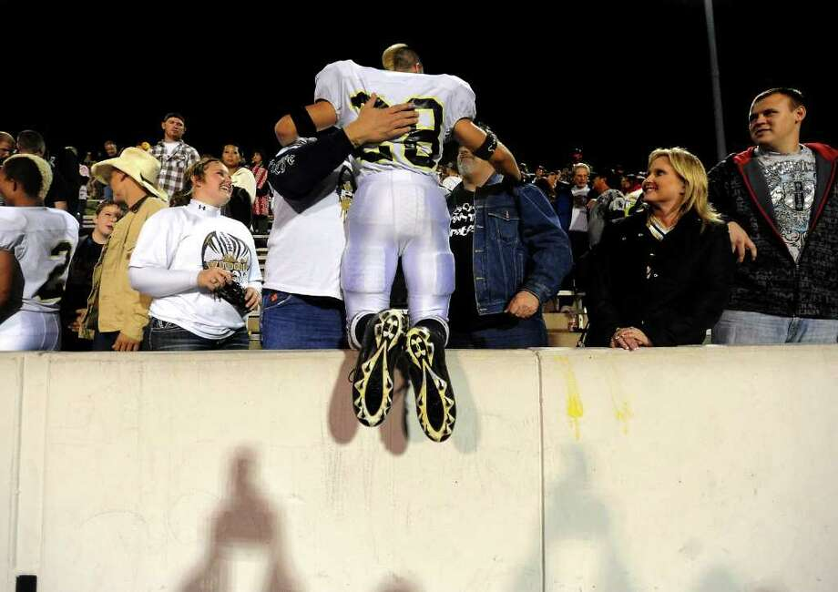 Vidor's Celly Thomas jumps into the waiting arms of his fans after beating Montgomery at Thorne Stadium in Aldine, Friday, November 18, 2011. Tammy McKinley/The Enterprise Photo: TAMMY MCKINLEY