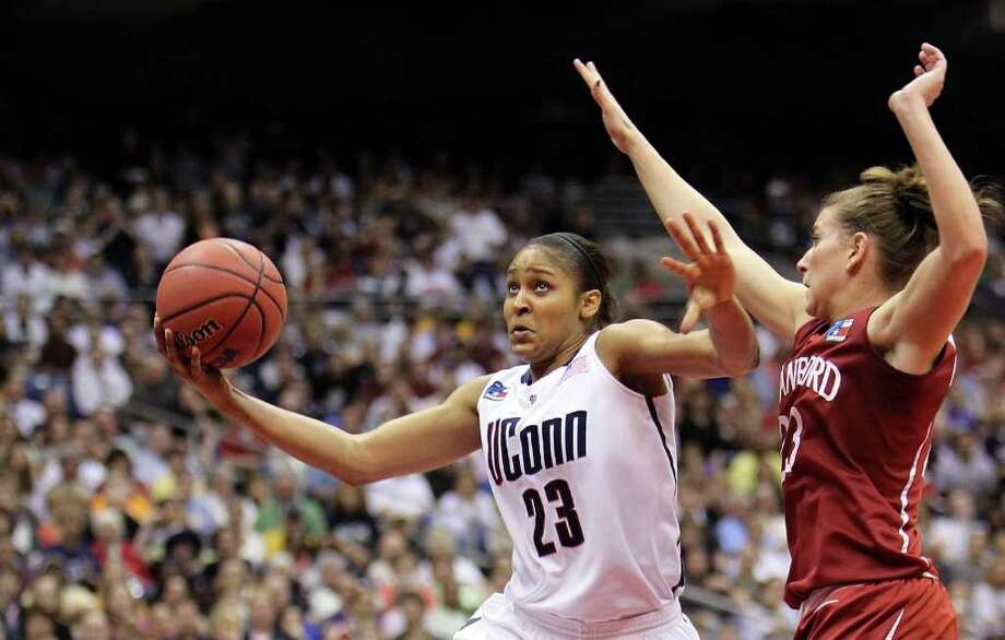 SAN ANTONIO - APRIL 06:  Forward Maya Moore #23 of the Connecticut Huskies takes a shot against Jeanette Pohlen #23 of the Stanford Cardinal during the NCAA Women's Final Four Championship game at the Alamodome on April 6, 2010 in San Antonio, Texas.  (Photo by Ronald Martinez/Getty Images) Photo: Ronald Martinez, Getty Images / 2010 Getty Images
