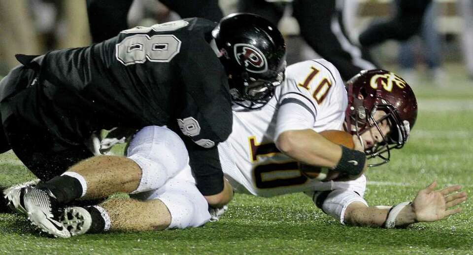 11/18/11: Quarterback Austin Rainer (10) of the Deer Park Deer is sacked by defensive end Ryan Grisw