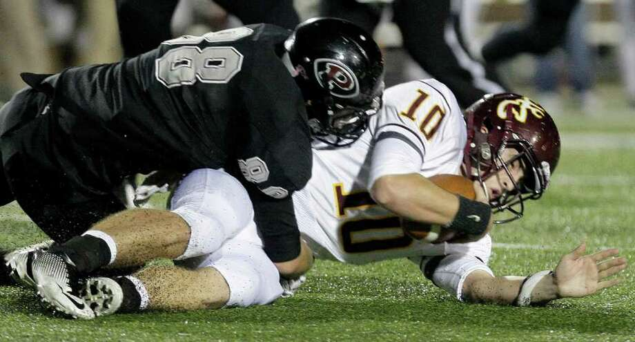 11/18/11: Quarterback Austin Rainer (10) of the Deer Park Deer is sacked by defensive end Ryan Griswold (88) of the Pearland Oilers  in an area high school football playoff game at GPISD Stadium in Houston, Texas. Photo: Thomas B. Shea, For The Chronicle / © 2011 Thomas B. Shea