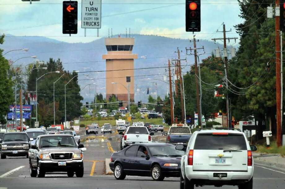 In this photo taken Oct. 4, 2011, the control tower at the Rogue Valley International-Medford Airport is seen from the road in Medford, Ore. The City Council on Thursday, Nov. 17, 2011, voted to approve a change tot he city code to allow the airport to brand the tower with a corporate log. The airport manager plans to use the $3,000 a month to lower landing fees. (AP Photo/Medford Mail Tribune, Bob Pennell) Photo: Bob Pennell / AP2011