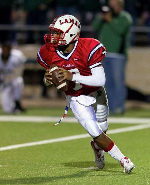 Lamar quarterback Darrell Colbert (7) rolls out  looking for a receiver during an area high school p
