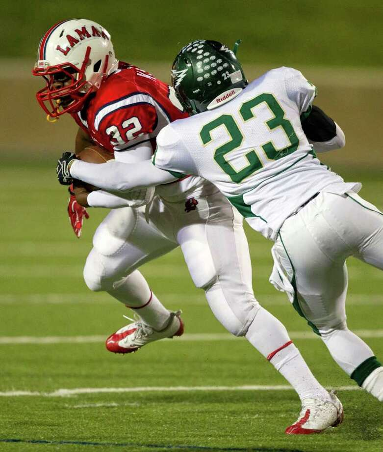 Lamar running back London Kirby (32) tries to avoid a tackle from Cy Falls' Justin Eke (23) during an area high school playoff game between Cy Falls and Lamar November 18, 2011 at Tully Stadium in Houston, Texas. Photo: Bob Levey, Houston Chronicle / ©2011 Bob Levey