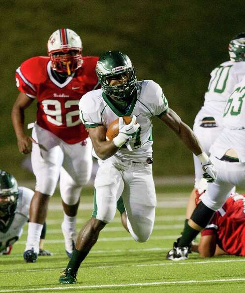 Cy Falls' Tre' Jerrols (21) rushes in the second quarter during an area high school playoff game bet