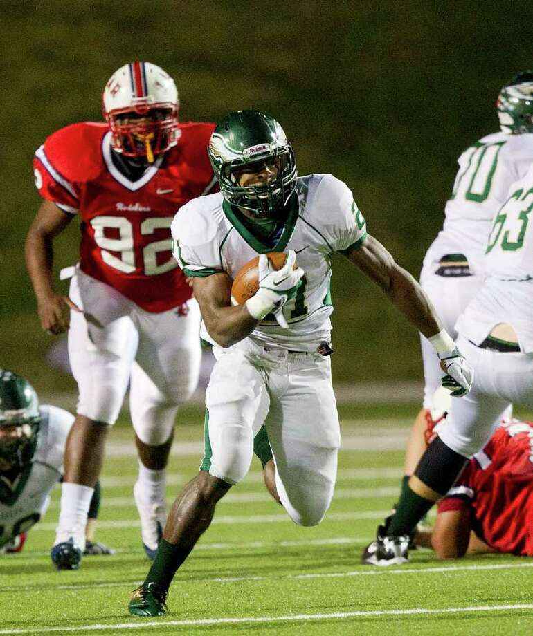 Cy Falls' Tre' Jerrols (21) rushes in the second quarter during an area high school playoff game between Cy Falls and Lamar November 18, 2011 at Tully Stadium in Houston, Texas. Photo: Bob Levey, Houston Chronicle / ©2011 Bob Levey