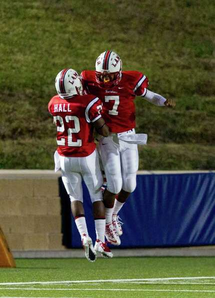 Lamar quarterback Darrell Colbert (7) and Kevan Hall (22) celebrate after a quick Lamar touchdown in