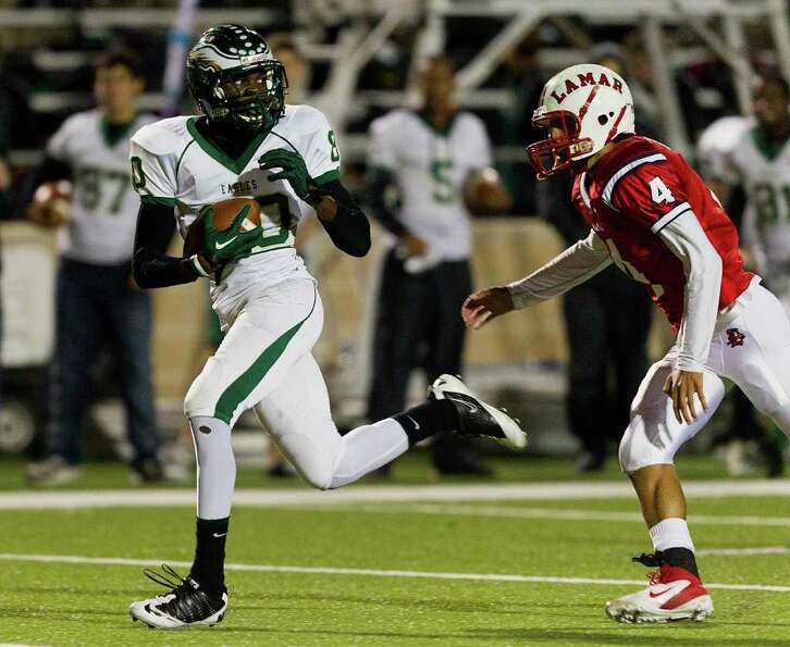Cy Falls' Isaiah White (80) slips behind Lamar's John Bonney (4) for a big reception during a area h