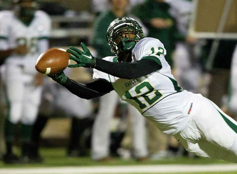 Cy Falls' Jacob Poole (12) has the ball just slide off his fingertips during an area high school pla