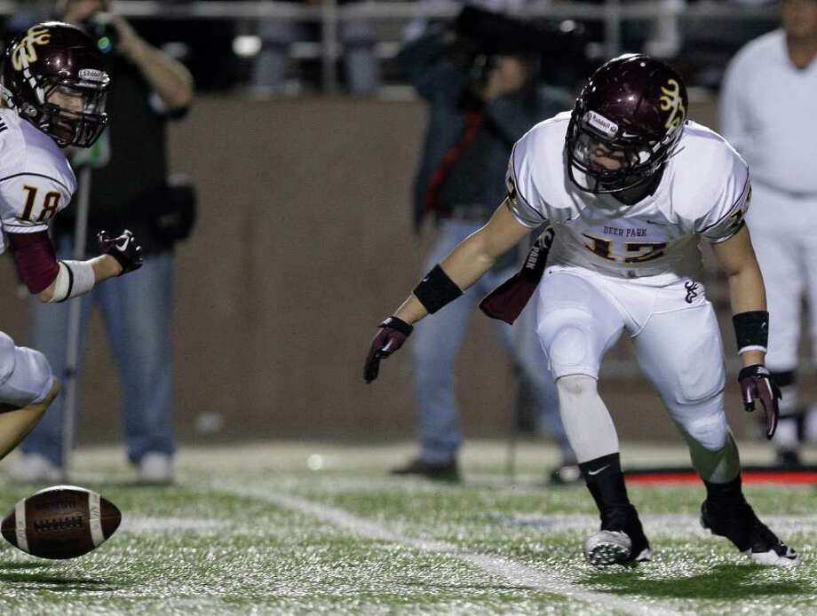 Pearland 47, Deer Park 7Special team players Cole Bedford (12) of the Deer Park Deer fumbles the kick off turning the ball over to the Pearland Oilers  in an area high school football playoff game at GPISD Stadium in Houston, Texas. Photo: Thomas B. Shea, For The Chronicle / © 2011 Thomas B. Shea