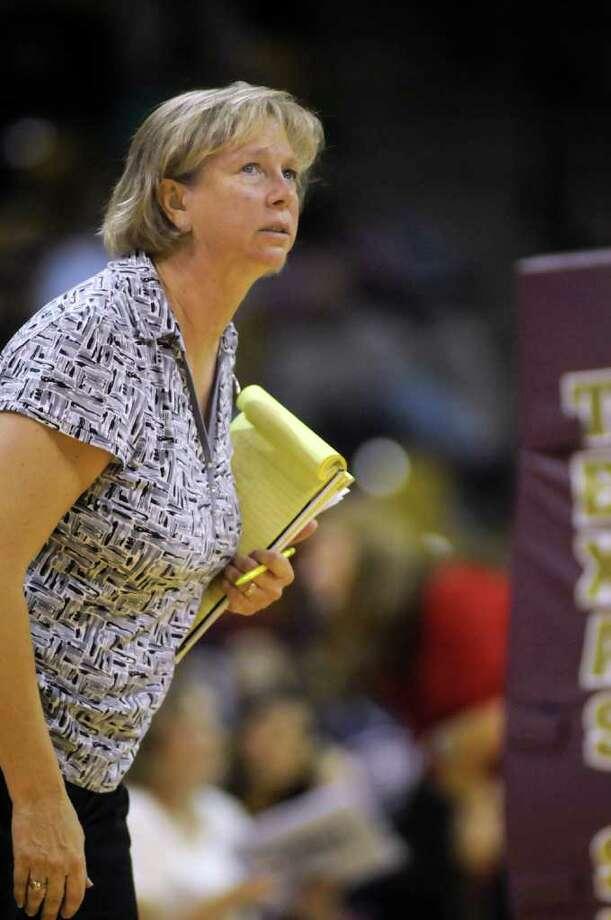 Cy-Falls Head Coach Kathy Stephenson checks the scoreboard during her team's  Class 5A state volleyball semifinal versus McKinney Boyd at Strahan Coliseum on the campus of Texas State University in San Marcos on Friday. Freelance photo by Jerry Baker Photo: Jerry Baker, For The Chronicle