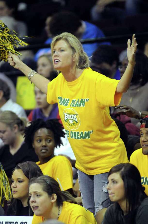 Shannon Dawley, the mom of Cy-Falls senior Libero Brittnee Dawley, cheers on the Golden Eagle's during their Class 5A state volleyball semifinal versus McKinney Boyd at Strahan Coliseum on the campus of Texas State University in San Marcos on Friday. Freelance photo by Jerry Baker Photo: Jerry Baker, For The Chronicle