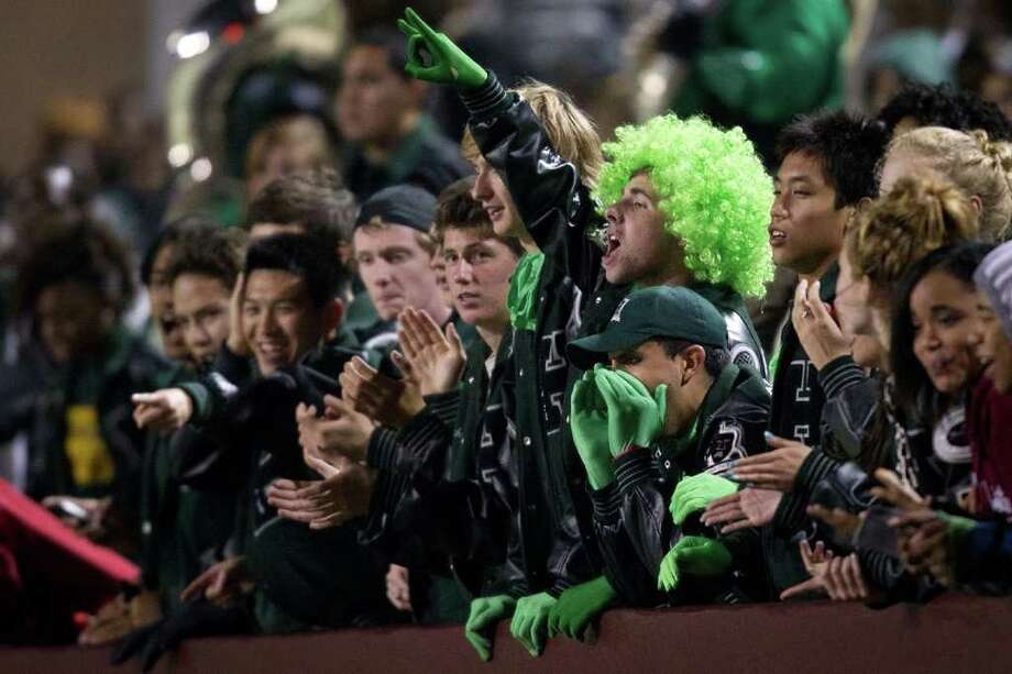Hightower fans cheer their team on against North Shore during the second half of high school football playoff action at Abshier Stadium on Friday, Nov. 18, 2011, in Deer Park .  Hightower won the game 34-21. Smiley N. Pool / Houston Chronicle ) Photo: Smiley N. Pool, Houston Chronicle / © 2011  Houston Chronicle