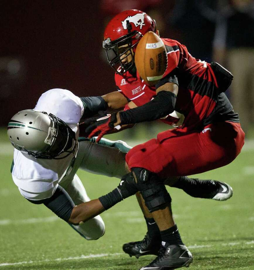 North Shore running back Kevin Alexander (15) fumbles as he is hit by Hightower defensive back Jordan Bell Photo: Smiley N. Pool, Houston Chronicle / © 2011  Houston Chronicle